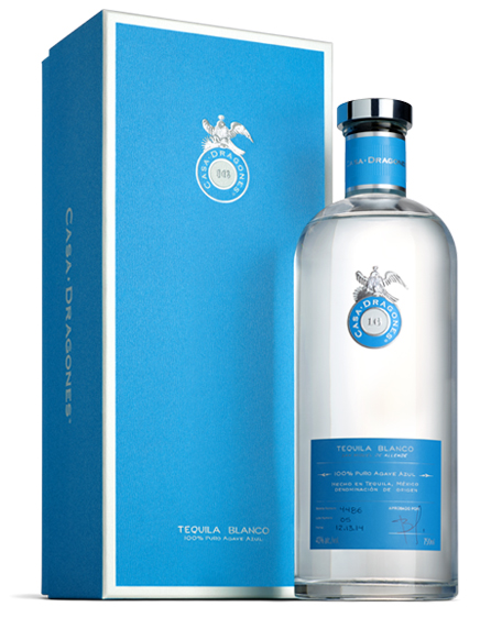 Tequila Casa Dragones Blanco, next to blue packaging.