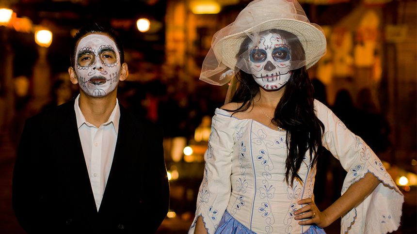 man and woman in day of the dead makeup