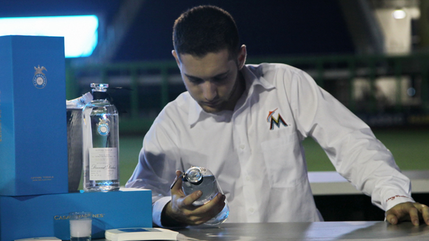 man holding bottle of tequila