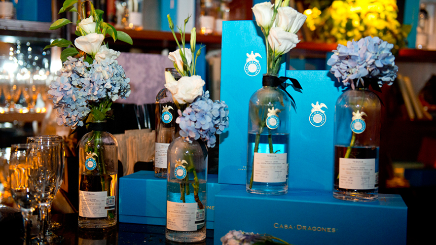 tequila bottles with flower arrangements