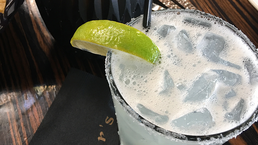 The Marco Margarita in a salt rimmed glass with a lime wedge